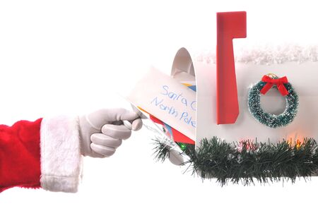 santa hand: Santa Claus Opening His Mailbox stuffed with letters. Horizontal composition isolated on white, Hand and arm only.