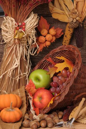 Fall Still Life with Pumpkins, cornucopia and fresh fruits. Vertical Composition. photo