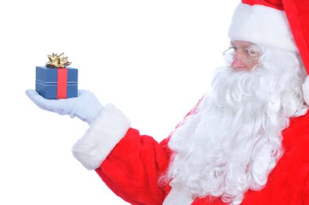Profile of Santa Claus with Present on his extended hand, isolated on white Stock Photo - 5836319