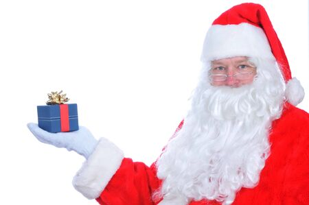 Santa Claus with Present on his extended hand Stock Photo - 5836318