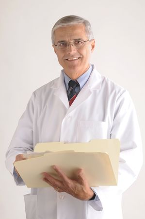 50 yrs: Middle Aged Doctor in Lab Coat Holding Folder with Patients Chart vertical format over gray background
