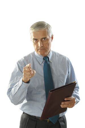 50 yrs: Middle Aged Businessman with a serious look holding a leather folder and pointing at camera vertical format torso only