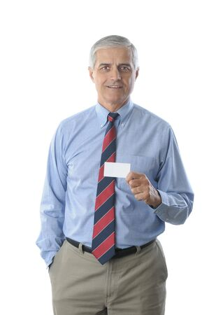 Businessman holding blank business card isolated on white vertical format torso only photo