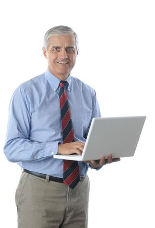 50 yrs: Middle Aged Businessman holding Laptop isolated over white vertical format torso only