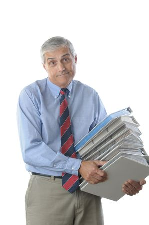 50 yrs: Overworked Businessman with frustrated expression Carrying a Large Stack of NoteBooks isolated over white vertical format torso only Stock Photo