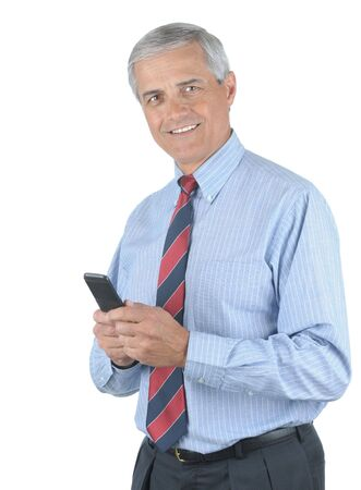 50 yrs: Smiling Middle aged businessman holding his cell phone in both hands isolated over white