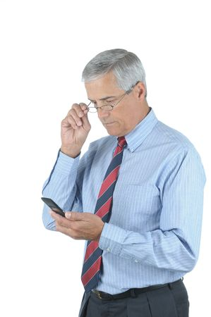 Middle Aged Businessman Looking at Cell Phone while adjusting his eye glasses isolated over white