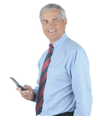 50 yrs: Smiling Middle aged businessman holding his cell phone isolated over white