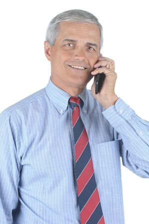 50 yrs: Smiling Middle aged businessman talking on his cell phone isolated over white