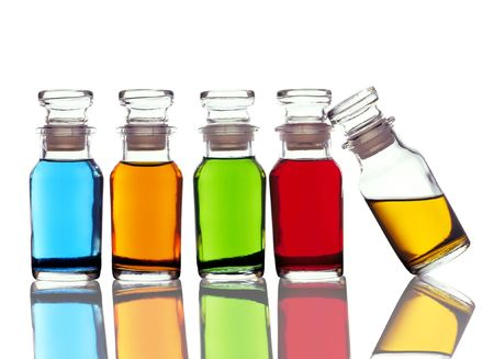 Apothecary bottles with colored liquid horizontal format with reflection