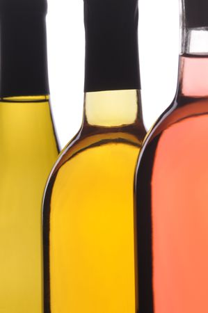Abstract Close up of Three Different Wine Bottles on white background vertical format Stock Photo - 6710975