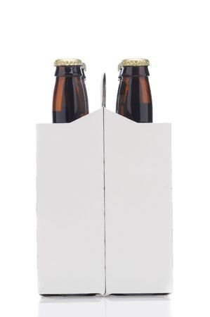 End View of a Six Pack of Brown Beer Bottles in Cardboard Carrier isolated on white with reflection vertical format Stock Photo