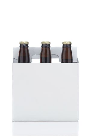 Side View of a Six Pack of Brown Beer Bottles in Cardboard Carrier isolated on white with reflection vertical format photo