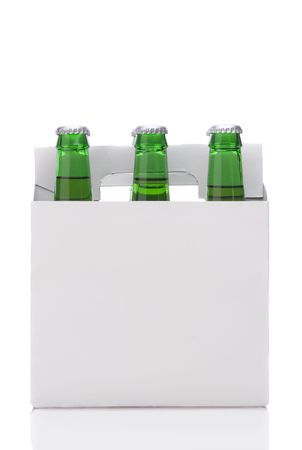 Six Pack of Green Beer Bottles in Cardboard Carrier isolated on white with reflection vertical format Stock Photo - 6710940
