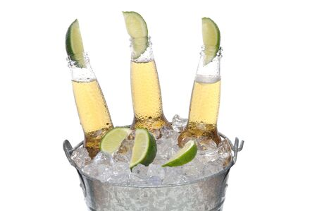 beer bucket: Three Clear Beer Bottles with lines in the necks in a bucket of ice isolated on white horizontal format Stock Photo