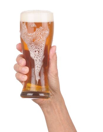 Man's Hand Holding up a Glass of Foamy Beer with froth dripping down the side over a white background Stock Photo - 6710976
