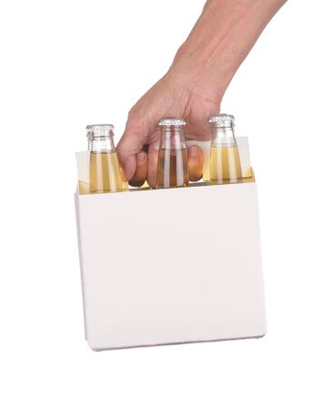 Mans Hand holding a six pack of clear beer bottles isolated over a white background