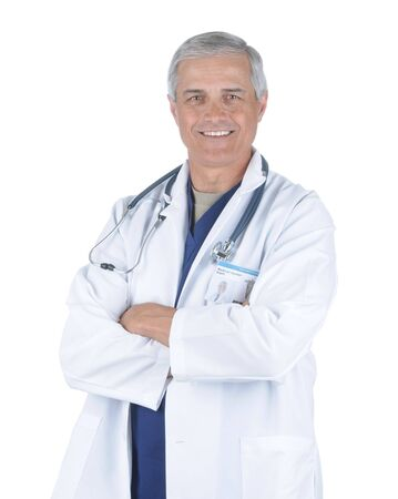 50 yrs: Middle Aged Male Doctor in Lab Coat and Scrubs with Arms Folded and Stethoscope around his neck isolated on white Stock Photo