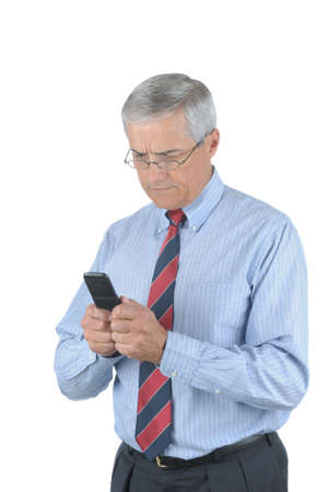 50 yrs: Middle Aged Businessman trying to send a text message from his Cell Phone isolated over white Stock Photo