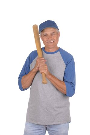 vertical format: Smiling middle aged man ready to play baseball. Man is holding a wood baseball bat over his shoulder. 34 view of man shot in Vertical format isolated over white.
