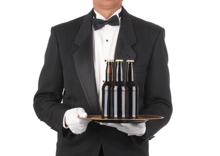 Butler in Tuxedo torso only with three bottles of Beer on Tray isolated on white photo