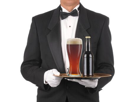 Butler in Tuxedo torso only with Bottle and Glass of Beer on Tray isolated on white  photo