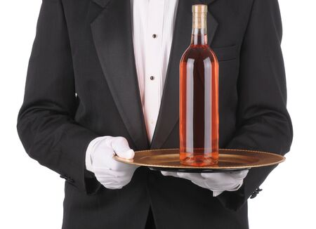Butler wearing a tuxedo holding a Wine Bottle on Tray. Square Format showing persons torso only. Stock Photo - 6979777