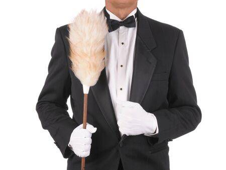 Butler in a tuxedo Holding a duster isolated on white torso only photo