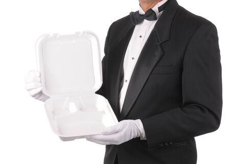 Butler in tuxedo torso only holding a Take-out Food Container isolated over white Stock Photo - 6961337
