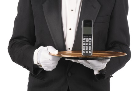 Butler Holding a cordless telephone on a tray isolated on white torso only photo