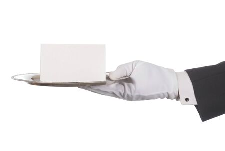 Butlers hand holding silver tray and blank note. Horizontal format arm with hand outstretched from right side isolated on white