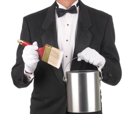 Butler wearing a tuxedo holding a Paint can and Brush isolated on white. Square format showing only the persons torso.