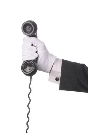 receiver: Butler Holding an old fashioned telephone receiver isolated over white hand and arm only