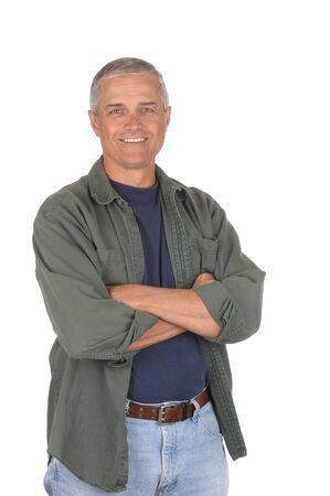 shirt unbuttoned: Casually dressed middle aged man with arms folded. 34 view of man shot in vertical format isolated on white. Stock Photo