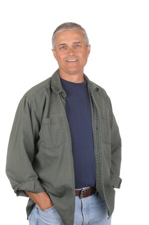 50 yrs: Casually dressed middle aged man with hands in jeans pockets. 34 view of man shot in vertical format isolated on white. Stock Photo
