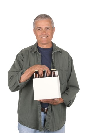 Smiling middle aged man carrying a six pack of beer isolated over white. Beer carrier is blank and the brown bottles have no labels. 3/4 view of the man in vertical format.