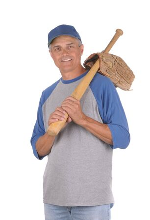 Smiling middle aged man ready to play baseball. Man is holding a wood baseball bat over his shoulder with the handle through glove opening. 34 view of man shot in Vertical format isolated over white. photo