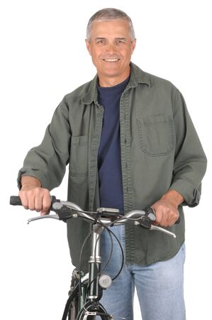 Smiling Middle Aged Man standing next to his bicycle. Man is looking at camera with his hands on the handlebars of the bike. 3/4 view of man shot in vertical format isolated on white.