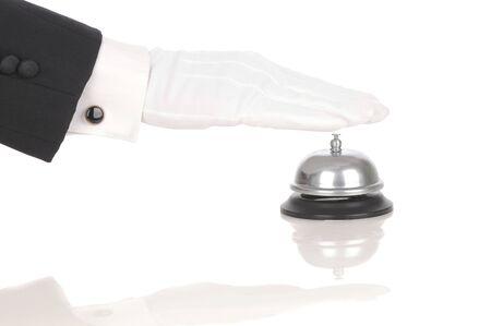 cuff link: Butlers gloved hand extended over service bell isolated on white. Hand and arm only in horizontal format with reflections.