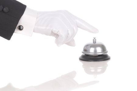 Butlers gloved hand extended over service bell isolated on white. Hand and arm only in horizontal format with reflections.