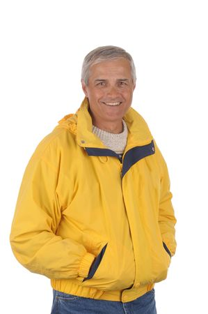 anorak: Middle aged man wearing a yellow anorak isolated over white