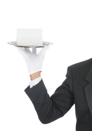 Butler wearing tuxedo and formal gloves holding a Blank Card on a silver tray. Shoulder hand and arm only isolated on white vertical composition. Stok Fotoğraf