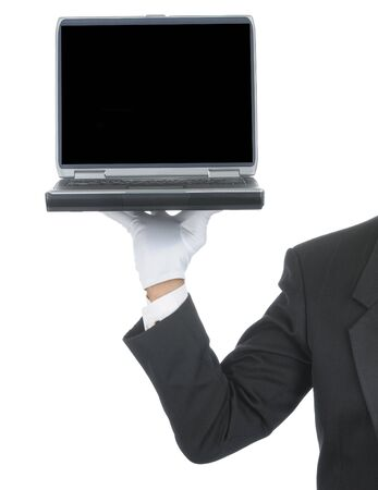 Butler wearing tuxedo and formal gloves holding a laptop computer on his hand. Shoulder hand and arm only isolated on white vertical composition.