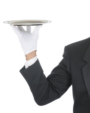 serving tray: Butler wearing tuxedo and formal gloves holding a silver tray. Shoulder hand and arm only isolated on white vertical composition.