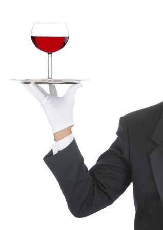 Butler wearing tuxedo and formal gloves holding a heart shaped box on a silver tray. Shoulder hand and arm only isolated on white vertical composition. Stock Photo - 7059058