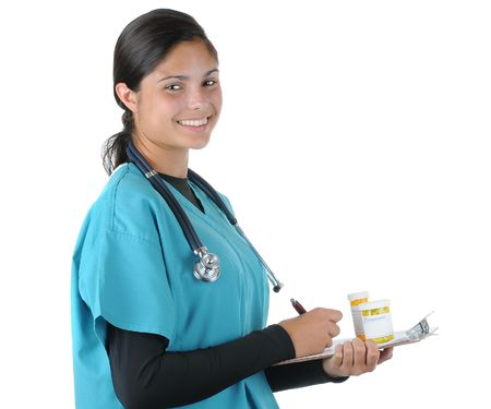 Smiling female medical professional in scrubs Holding clip board and prescription bottles. Square format isolated on white. Stock Photo - 7185833