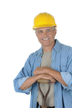 manuals: Workman leaning on the handle of his shovel. Man is wearing a hard hat and smiling at the camera. Isolated over white in vertical format.