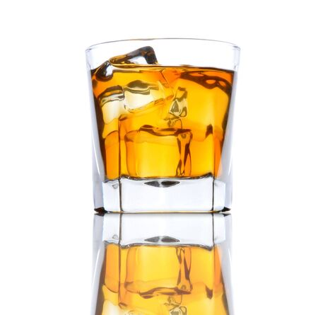 barware: Glass of Whiskey with ice from a low angle on black bar counter white background