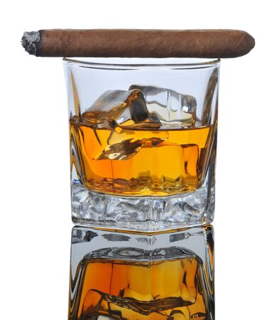 Lit Cigar on Whiskey Glass with Ice Cubes and reflections in Table Top - white background