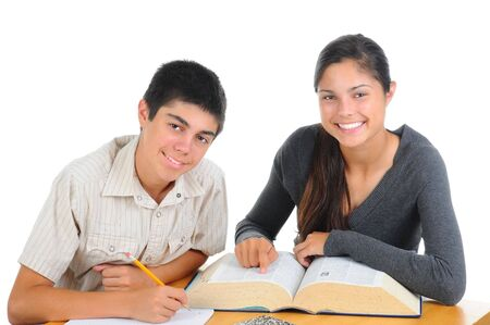 school notebook: Two students studying together. Teenage boy and girl with large reference book on their desk. both are smiling at the camera. Horizontal format isolated on white.